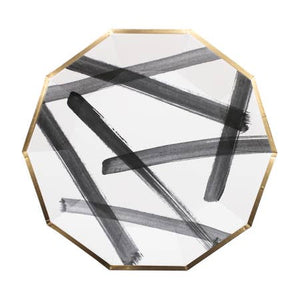 "Feeling bold? Create a contemporary tablescape and strike up new conversations with your guests with our daring black and white brushstroke party plates! Inset with a chic gold trim on decagon, celebrate your next shower, birthday, or special event for an elegant gathering. Colors: Black, white, gold foil Paper Plates Approx. 9.75"" Corner to Corner 8 Plates / Pack"
