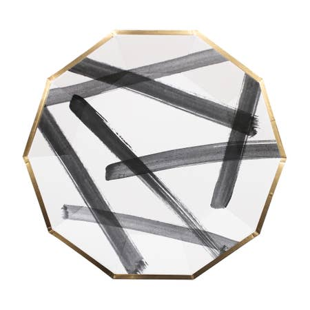 Feeling bold? Create a contemporary tablescape and strike up new conversations with your guests with our daring black and white brushstroke party plates! Inset with a chic gold trim on decagon, celebrate your next shower, birthday, or special event for an elegant gathering. Colors: Black, white, gold foil Paper Plates Approx. 9.75