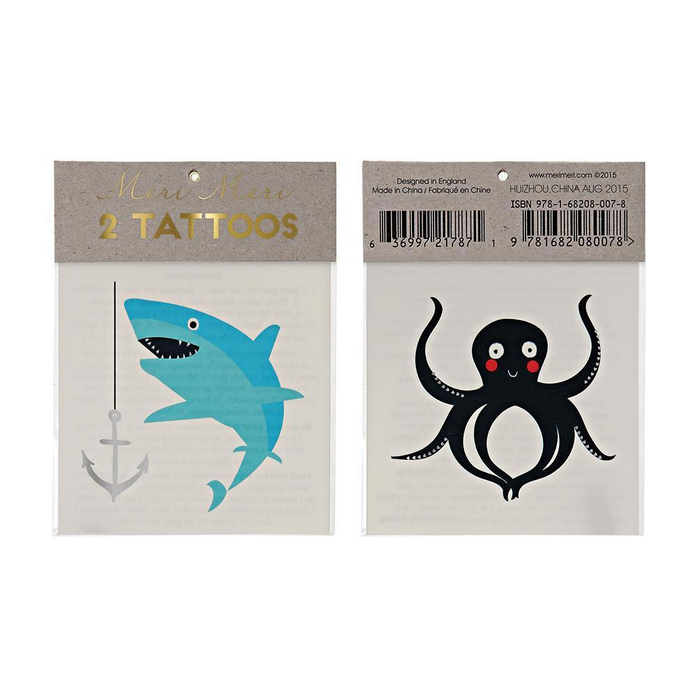 From party favors to little gifts, our temporary tattoos are sure to be a hit with big kids and small, whether it's a special occasion or just a way to pass the time on a rainy afternoon. Easy to apply and gentle on the skin, this pack contains transfer instructions, a fearsome shark tattoo and an adorable octopus tattoo, in striking colors with silver details.    Pack of 2 sheets Temporary Gold foil detail