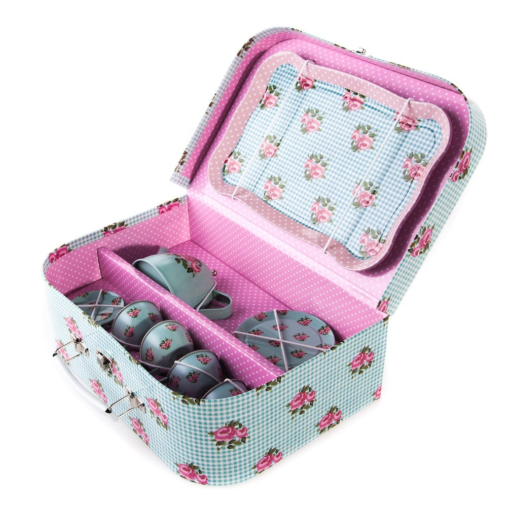 Kids love our picnic box set in blue. Play tea parties with our adorable little blue tea set with pink rose designs. Includes a complete tea set made from tin with a pretty laminated cardboard suitcase to keep it all together.  Material - Laminated Cardboard, Metal, Plastic