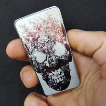 dead skull electric lighter hands on closed view the flame x