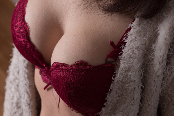 breasts with red lacy bra