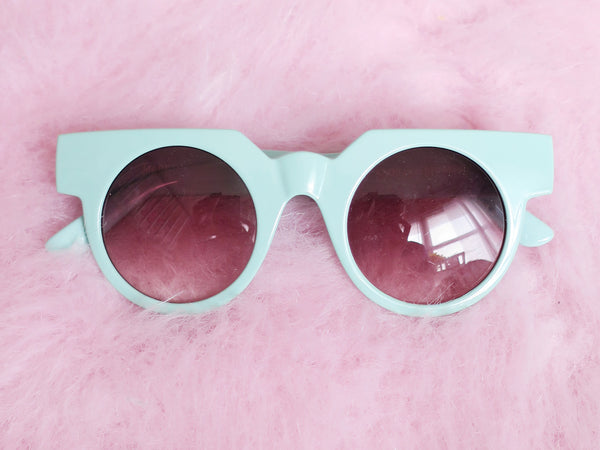 Mint green round sunglasses