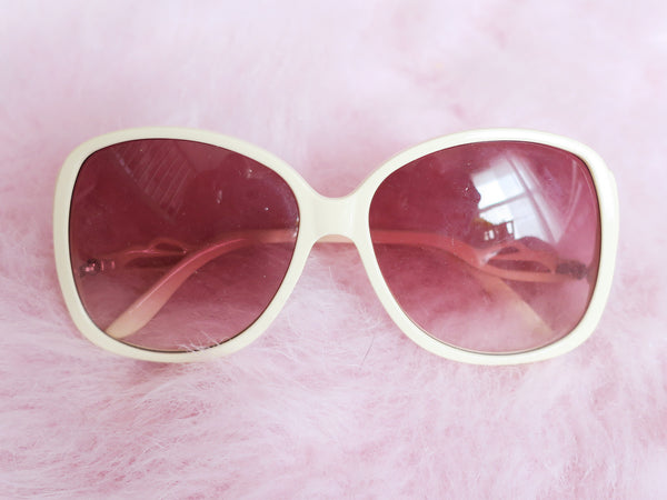 Cream drop-arm sunglasses with rose tinted lenses