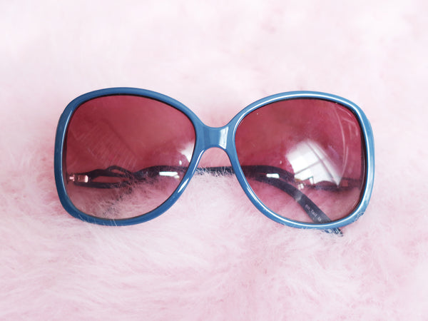 Steel blue drop-arm sunglasses with rose tinted lenses