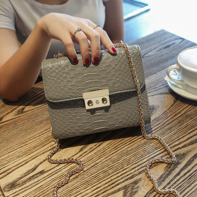 Mini women's leather crocodile bag