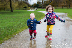 Children running through puddles