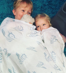 Children using Tiny Chipmunk 100% bamboo muslin swaddle blanket as bed sheet