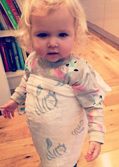 Toddler wearing Tiny Chipmunk 100% bamboo muslin swaddle blanket as a sarong