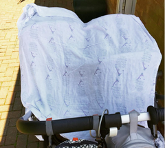 Using Tiny Chipmunk 100% bamboo muslin swaddle blanket as sun shade on double buggy