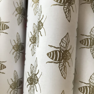 Bee wrapping paper in gold