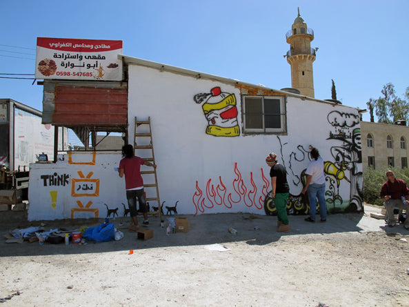 Painting a wall in Bethlehem on the roadtrip