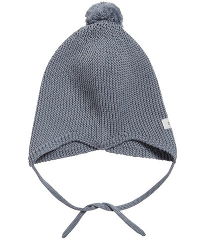 Knitted hat with ties and pom-pom