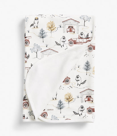 Blanket with raccoon print