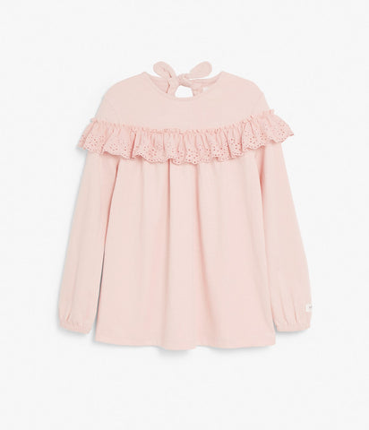 Top with ruffles and bow on back
