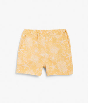 Kids yellow turtle and shell printed shorts