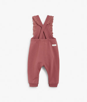 Baby pink overalls with lace ruffles