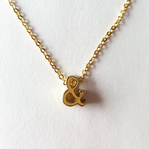 ampersand necklace in gold