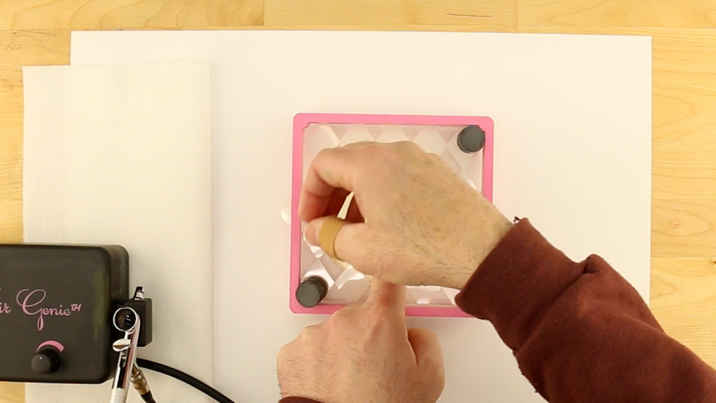 Use cookie magnets to help stencil lay flat