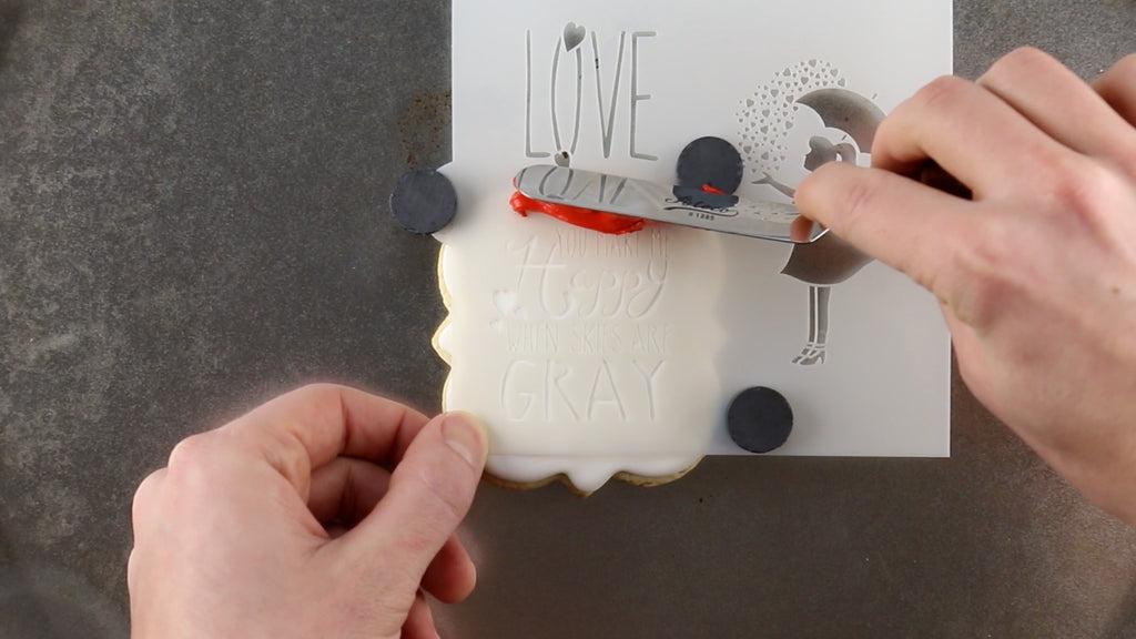 Use cookie magnets to hold the cookie stencil in place