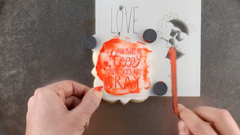 Scrape off all the excess royal icing