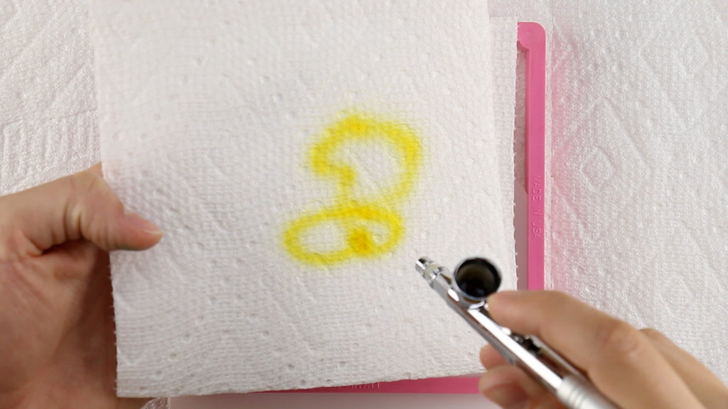 Load Amerimist into the Stencil Genie and test it on paper towel