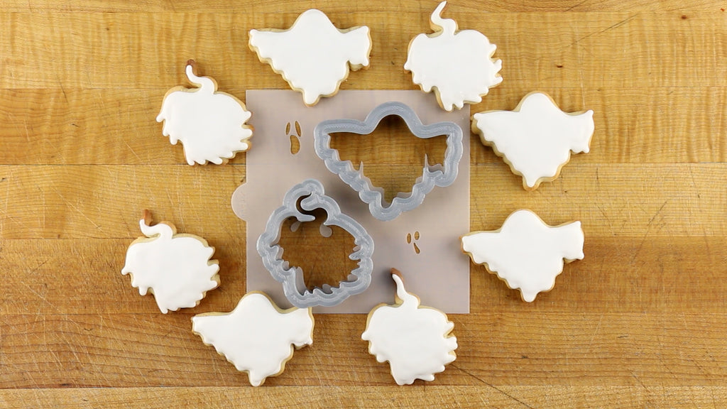 The cookie cutters line up perfectly with the cookie stencil
