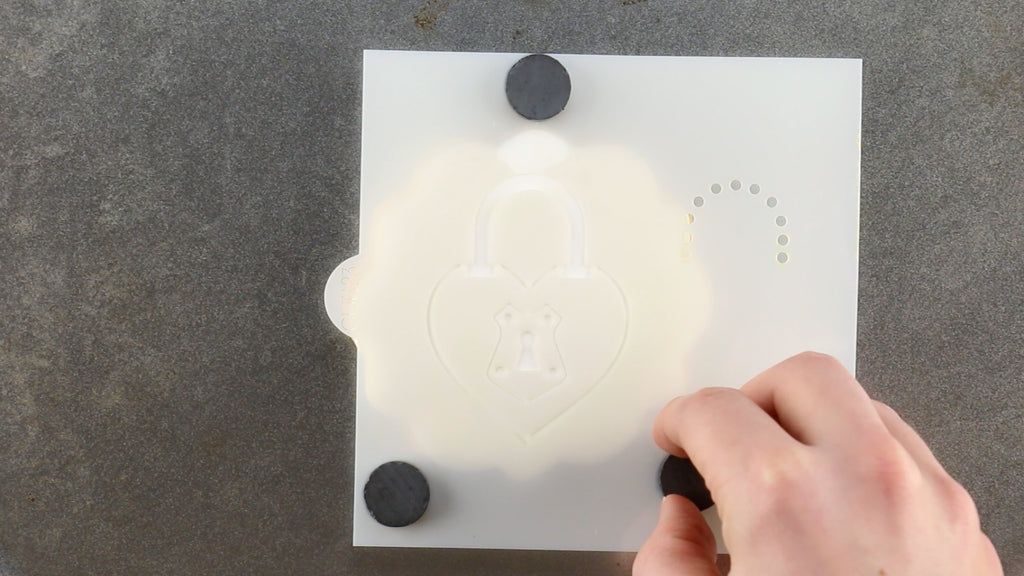Line up the stencil with stencil magnets