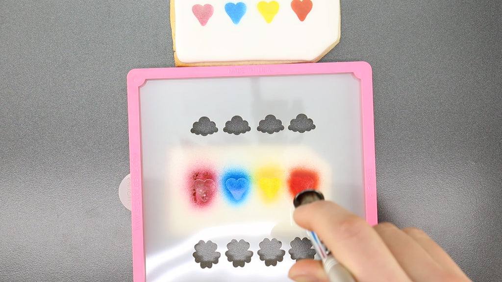 Use your airgenie airbrush to stencil the cookie color palette