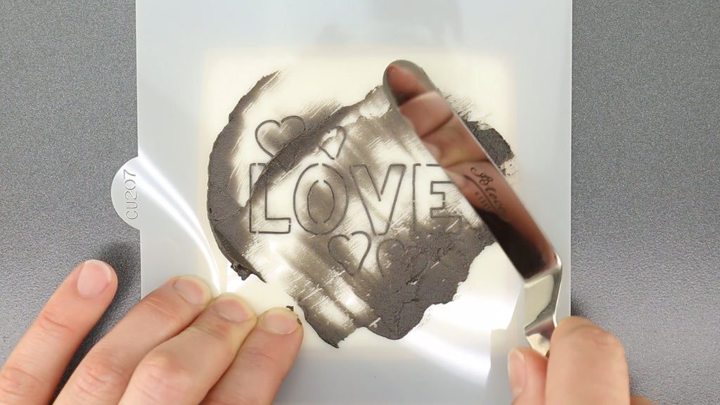 Spread royal icing through the stencil