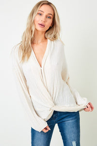 Ribbed knit top with twist front detail & balloon sleeves