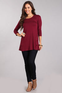 Solid 3/4 sleeve knit top / button trim detail