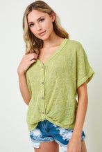 Lightweight knit button down top with a twist front detail