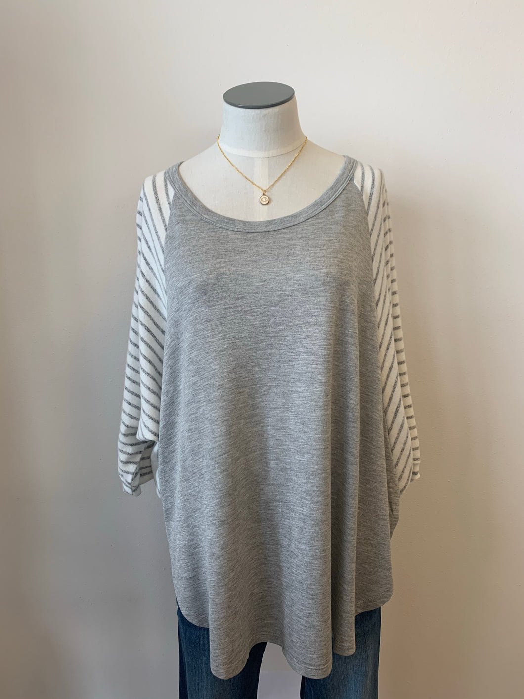 Draped loose fit solid & stripe top