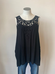 Solid crochet lace trimmed sleeveless top