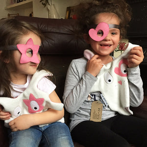 Two girls playing with pink Doudoods star + heart dress up eye patches