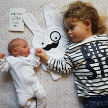 The Doudoods white + black monocle style baby comforter with a newborn & her big sister with a welcome to the world card