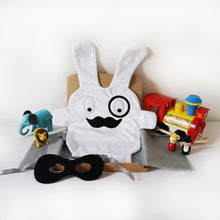 The Doudoods white + black monocle style baby comforter with black bandit mask as featured in the sibling pack