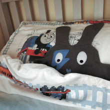 Grey & blue Flash Doudoods comforter in train bed
