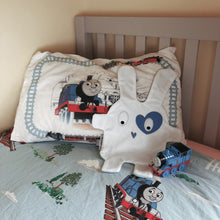 The Doudoods white + blue heart style baby comforter on toddler bed
