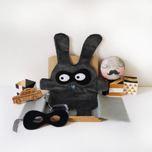 The Doudoods grey + black bandit style comforter with superhero mask as sold as sibling pack