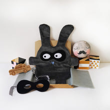 The Doudoods grey + black bandit style baby comforter with black bandit mask as part of sibling pack