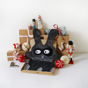 The Doudoods grey + black bandit style baby comforter with Christmas presents