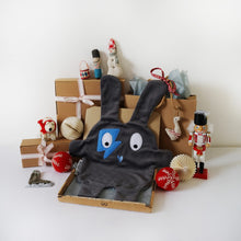 The Doudoods grey + blue flash style baby comforter with Christmas presents