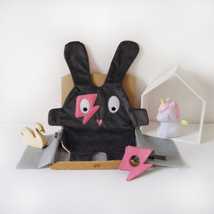The Doudoods grey + pink flash style baby comforter with pink flash style eye patch as part of sibling pack