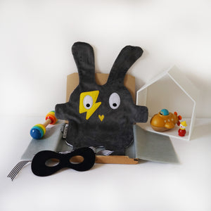 The Doudoods grey + yellow flash style baby comforter with black bandit mask as part of sibling pack