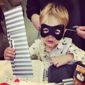 Toddler buying The Doudoods black superhero dress up mask bandit style