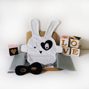 The Doudoods white + black heart style baby comforter with black bandit style dress up mask as featured in sibling pack