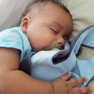 Baby boy sleeping cuddling The Doudoods grey + blue baby comforter