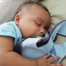 Baby boy sleeping cuddling a grey + blue The Doudoods baby comforter
